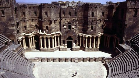 """Continually inhabited for 2,500 years, and became the capital of the Romans' Arabian empire. The centerpiece is a magnificent Roman theater dating back to the second century that survived intact until the current conflict. Archaeologists have revealed the site is now severely <a href=""""http://ghn.globalheritagefund.com/uploads/documents/document_2107.pdf"""" target=""""_blank"""" target=""""_blank"""">damaged from mortar shelling</a>."""