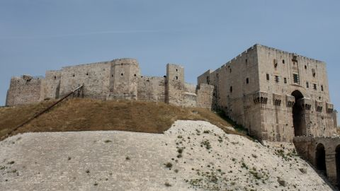 """The fortress spans at least four millennia, from the days of Alexander the Great, through Roman, Mongol, and Ottoman rule. The site has barely changed since the 16th century and is one of Syria's most popular World Heritage sites. The citadel has been used as an army base in recent fighting and several of its historic buildings <a href=""""http://projects.nytimes.com/watching-syrias-war/footage-shows-damage-to-aleppo-citadel"""" target=""""_blank"""" target=""""_blank"""">have been destroyed</a>."""