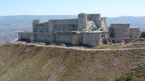 """The Crusader castle from the 11th century survived centuries of battles and natural disasters, becoming a World Heritage site in 2006 along with the adjacent castle of Qal'at Salah El-Din. The walls were severely damaged by <a href=""""http://ghn.globalheritagefund.com/uploads/documents/document_2107.pdf"""" target=""""_blank"""" target=""""_blank"""">regime airstrikes and artillery in 2013</a>, and rebels took positions within it."""