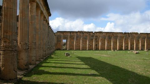 """A key city for the Greeks and Romans, established in 630 BC. Famed as the basis for enduring myths and legends, such as that of the huntress heroine of the same name and bride of Apollo. The ruins were some of the best preserved from that period, but in the wake of Libya's revolution, <a href=""""http://www.thetimes.co.uk/tto/news/world/middleeast/article3856669.ece"""" target=""""_blank"""" target=""""_blank"""">vast tracts have been bulldozed</a> including its unique necropolis complex."""