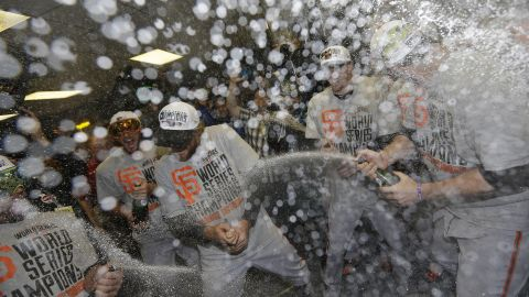 The San Francisco Giants celebrate after Game 7 of the World Series against the Kansas City Royals, October 29 in Kansas City, Mo. The Giants won 3-2 to win the series.