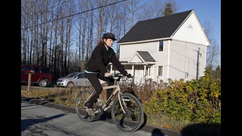 """Kaci Hickox leaves her home in Fort Kent, Maine, to take a bike ride with her boyfriend on October 30, 2014. Hickox, a nurse, recently returned to the United States from West Africa, where she treated Ebola victims. State authorities wanted her to avoid public places for 21 days -- the virus' incubation period. But Hickox, who twice tested negative for Ebola,<a href=""""http://www.cnn.com/2014/10/30/health/us-ebola/index.html""""> said she would defy efforts</a> to keep her quarantined at home."""