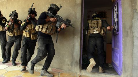 Iraqi special forces search a house in Jurf al-Sakhar, Iraq, on Thursday, October 30, after retaking the area from ISIS.