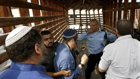 Israeli police scuffle with activists trying to enter the Temple Mount on October 30.