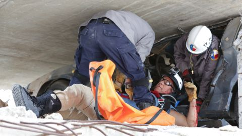 """<a href=""""http://www.cnn.com/SPECIALS/us/original-series-mike-rowe-somebodys-gotta-do-it/index.html"""" target=""""_blank"""">Mike Rowe, host of CNN's """"Somebody's Gotta Do It,""""</a> gets rescued by Texas A&M paramedics during a training exercise. Click through the gallery for more images of folks who #GottaDoIt and watch CNN in 2015 for Season 2."""