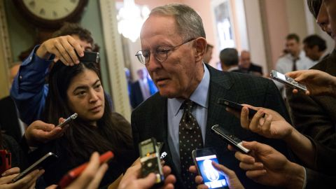 Sen. Lamar Alexander (R-TN) speaks to reporters before going into the Senate Chamber to vote, on October 12, 2013 in Washington, DC.