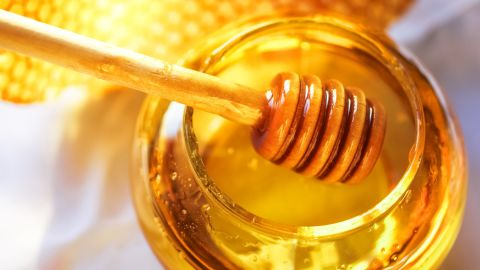 Honey is low in water and high in sugar, so bacteria cannot grow on it. It also contains small amounts of hydrogen peroxide, inhibiting the growth of microbes.
