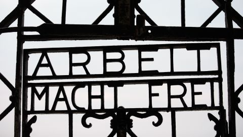 According to the Dachau Concentration Camp Memorial, the gate was forged by inmates in one of the camp's workshops after it first opened in 1933 for political prisoners.