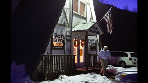 A voter exits the Valley Bible Chalet, which is a polling location in Indian, Alaska.