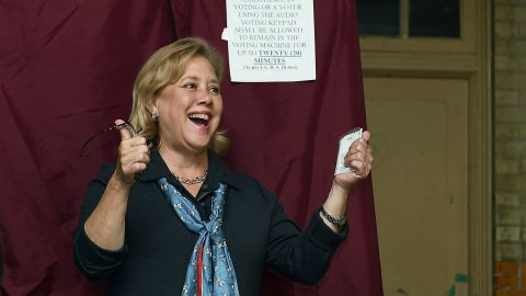 U.S. Sen. Mary Landrieu (D-LA) gives getures while her voting with her family in attendance on November 4, 2014 in New Orleans, Louisiana.