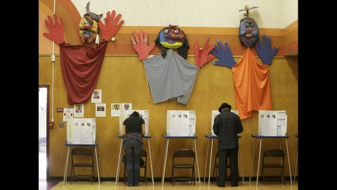Voters cast ballots at Manzanita Community School in Oakland, California.