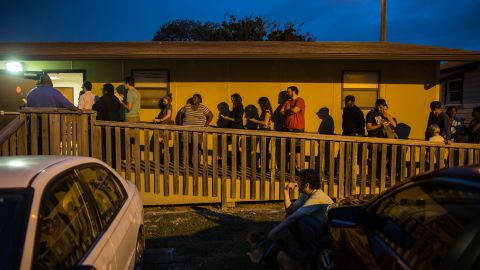Voters wait in line to cast their ballots in a portable structure outside of David Chapel Baptist Church in Austin, Texas.
