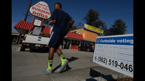 A man arrives to vote at the Avenue 3 Pizza shop in Long Beach, California.