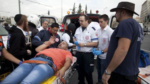 JERUSALEM, ISRAEL - NOVEMBER 05:  Israeli rescue workers and paramedics carry an injured man to an ambulance after a Palestinian man, Ibrahim al-Akri, was shot by Israeli police officers after he drove into a crowd of people on November 5, 2014 in Jerusalem, Israel. One person was killed and at least 13 people were wounded during the suspected terror attack near East Jerusalem on Wednesday.  (Photo by Lior Mizrahi/Getty Images)