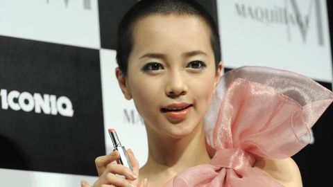 """Here, pop singer Iconiq displays a Shiseido lipstick on January 19, 2010, after becoming the model for the Japanese cosmetics giant's """"Maquillage"""" make-up brand."""