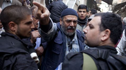 A Palestinian man argues with Israeli police officers as he waits to get permission to enter the Temple Mount on Wednesday, November 5, in Jerusalem. Police clashed with Palestinians there on Wednesday, leaving more than 15 people injured in the latest round of unrest at the holy site.