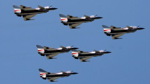 China's J-10 fighter jets perform during the 2010 airshow on November 17, 2010. The day before the show China won orders for 100 of its large, domestically built passenger jets, challenging industry giants Airbus and Boeing in what will soon be the world's largest aviation market.