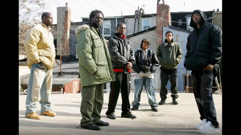 """No list of binge-worthy TV shows would be complete without HBO's """"The Wire,"""" which began to take off in the middle of its five-season run thanks to binge-watchers. Good news for those who want to binge-watch the old-fashioned way, with DVDs: The series was released on Blu-ray in 2015."""