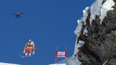 Drones soon became features of major sports events. Here, Canada's Erik Guay competes beneath a drone during an Alpine skiing World Cup downhill race in early 2012.