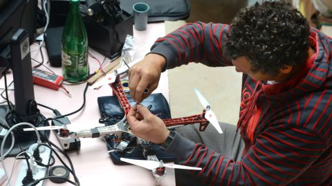 """Increasingly, pro athletes are using drones for their own benefit. <a href=""""http://cnn.com/2014/01/29/sport/xavier-de-le-rue-snowboarding-sochi/"""">French snowboarder Xavier de le Rue </a>is pictured working on a drone prototype in the summer of 2014."""