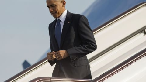 U.S. President Barack Obama steps off Air Force One as he arrives to attend the Asia-Pacific Economic Cooperation (APEC) Summit in Beijing, Monday, Nov. 10, 2014.