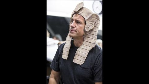 Rowe tries on one of the head pieces backstage at Pageant of the Masters.