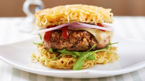 """The burger lends itself to mashups and variations by its sandwiched nature. The Original Ramen Burger, available at its namesake restaurant in Brooklyn, New York, was voted one of the """"<a href=""""http://newsfeed.time.com/2014/01/14/the-most-influential-burgers-of-all-time/slide/krusty-burger/"""" target=""""_blank"""" target=""""_blank"""">17 Most Influential Burgers of All Time</a>"""" by Time magazine in 2013. It consists of a ground beef patty sandwiched between two buns made from fresh ramen noodles."""