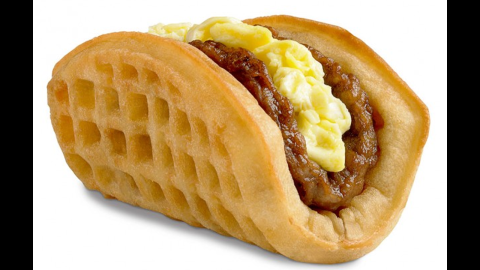 """Taco Bell debuted its breakfast menu in 2014 with its marquee item, the Waffle Taco. It's pretty much what it sounds like if you consider taco shells and waffles interchangeable vehicles for eggs and breakfast meats. As one headline summed it up, """"<a href=""""http://www.slate.com/blogs/moneybox/2014/09/05/taco_bell_breakfast_menu_the_biscuit_taco_joins_the_waffle_taco.html"""" target=""""_blank"""" target=""""_blank"""">Taco Bell Tacos Keep Getting Less and Less Taco-Like</a>."""""""
