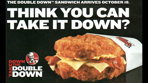 """Craving a hamburger, fried chicken and bacon all at once? KFC's Zinger Double Down<strong> </strong>has you covered. The hamburger topped with bacon, barbecue sauce and """"pepper dressing"""" sandwiched between two pieces of crispy fried chicken, um, doubles down on the fast-food chain's success with the original 2010 Double Down, pictured, a sandwich of bacon, cheese and the Colonel's sauce between two chicken fillets."""