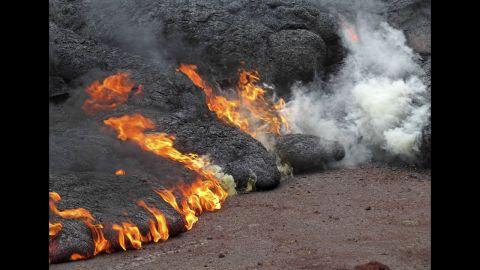 Lava burns near the town of Pahoa on Sunday, November 9.