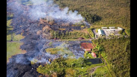 """Lava flows near a residential structure in Pahoa, Hawaii, on Monday, November 10. The lava flow from <a href=""""http://www.cnn.com/2014/10/28/us/hawaii-volcano/index.html?hpt=hp_c2"""" target=""""_blank"""">the Kilauea Volcano</a> is advancing on the community of about 950 people on Hawaii's Big Island and claimed its first home in the town, which has been watching the slow-moving flow approach for months."""
