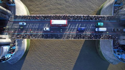 The new glass floor at the Tower Bridge spans 11 meters long between the north and south towers. London's red buses and black cabs can be seen from 42 meters above the River Thames.