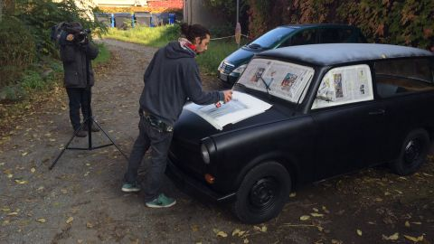 CNN hired the artist Martin Raumberger to give the car a makeover. He focused on three themes: Berlin, CNN, and the fall of the Berlin Wall.