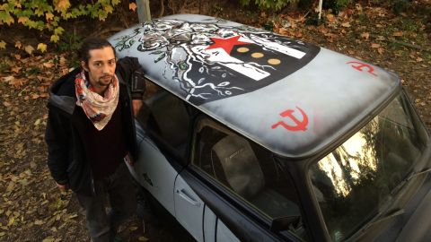 Raumberger sketched several of Berlin's most famous symbols on CNN's Trabi, including the broadcast tower and the Brandenburg Gate. He also drew a tree of people breaching the Berlin Wall, a symbol of human life penetrating and destroying the anti-human barrier that separated East and West Germany.