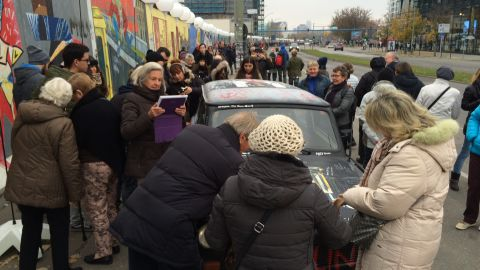 """""""On November 9, thousands of people crowded around our car to sign it, draw on it, and take their picture with it. At some point the authorities asked us to stop because the crowd grew so large that it was blocking the bike path and the street at the East Side Gallery,"""" says Pleitgen."""