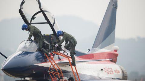 Pilots climb into a J-10 fighter jet on Tuesday, November 11, 2014.