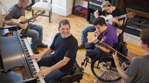 MusiCorps pairs professional musicians with recovering troops, helping them play instruments and write and record music.