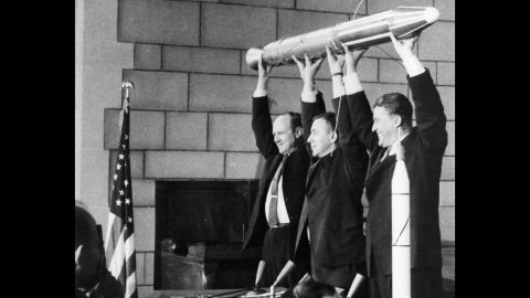 """A model of <a href=""""https://www.nasa.gov/mission_pages/explorer/explorer-overview.html"""" target=""""_blank"""" target=""""_blank"""">Explorer 1</a>, America's first satellite, is held by, from left, NASA official William Pickering, scientist James Van Allen and rocket pioneer Wernher von Braun. The team was gathered at a news conference at the National Academy of Sciences in Washington to announce the satellite's successful launch. It had been launched a few hours before, on January 31, 1958."""