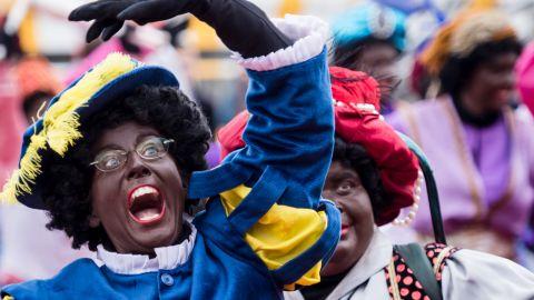 Actors dressed as Black Pete arrive on a boat in Antwerp, Belgium, on Saturday.
