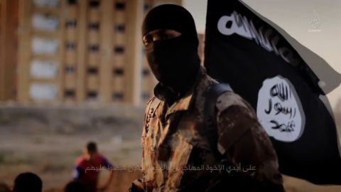 """An English-speaking ISIS fighter orchestrates the mass execution of a group of men in an ISIS recruitment video called """"Flames of War."""""""