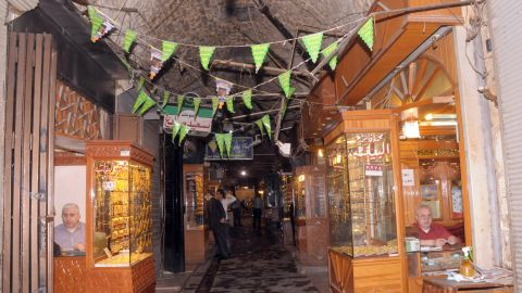 """The covered markets in the Old City are a famous trade center for the region's finest produce, with dedicated sub-souks for fabrics, food, or accessories. The tunnels became the scene of fierce fighting and many of the oldest are<strong> </strong>now damaged beyond recognition, which Unesco has<strong> </strong><a href=""""http://whc.unesco.org/en/news/940/"""" target=""""_blank"""" target=""""_blank"""">described as a tragedy</a>."""