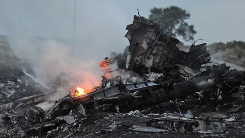 A picture taken on July 17, 2014 shows flames among the wreckage of MH17 in rebel-held eastern Ukraine.
