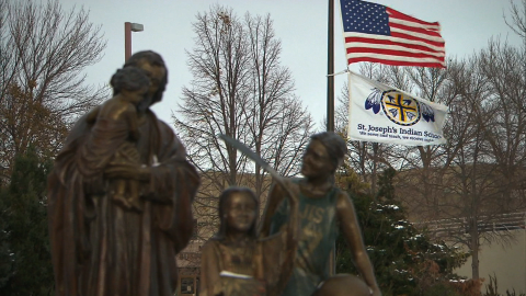 Flags fly at the entrance to St. Joseph's Indian School.