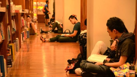 Customers at Eslite's bookstore on Dunhua Road, Taipei read books in the early hours. The store is open 24 hours a day.