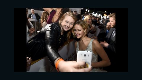 """Actress Jennifer Lawrence, right, poses with fan Chelsea Boyce at the release of the latest """"Hunger Games"""" movie Monday, November 17, in Los Angeles."""
