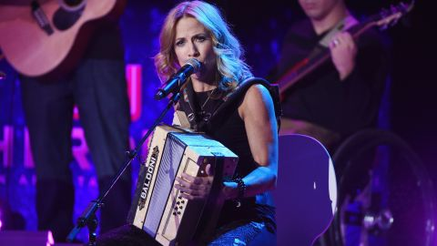 """Sheryl Crow performs """"Wide River to Cross"""" with CNN Hero Arthur Bloom and <a href=""""http://www.cnn.com/2014/11/21/world/gallery/cnn-heroes-arthur-bloom/index.html"""">his MusiCorps Wounded Warrior Band.</a>"""