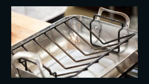 Set V-rack inside large roasting pan and spray with vegetable oil.