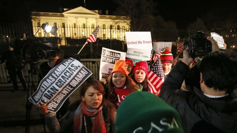 People chant during a demonstration in front of the White House in Washington, Thursday, Nov. 20, 2014, as President Barack Obama announced executive actions on immigration during a nationally televised address.