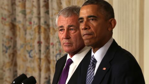 WASHINGTON, DC - NOVEMBER 24:  U.S. President Barack Obama (R) speaks as Secretary of Defense Chuck Hagel looks on during a press conference announcing Hagel's resignation in the State Dining Room of the White House November 24, 2014 in Washington, DC. Sources say Hagel plans to remain in office until his successor is confirmed by the Senate.  (Photo by Alex Wong/Getty Images)