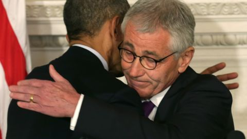 U.S. President Barack Obama (L) hugs Secretary of Defense Chuck Hagel during a press conference announcing Hagel's resignation in the State Dining Room of the White House November 24, 2014 in Washington, DC.